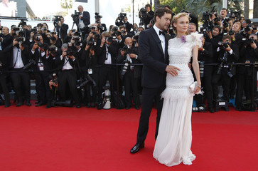 Jury member Kruger and actor Jackson arrive on the red carpet ahead of the screening of the film Killing Them Softly in competition at the 65th Cannes Film Festival