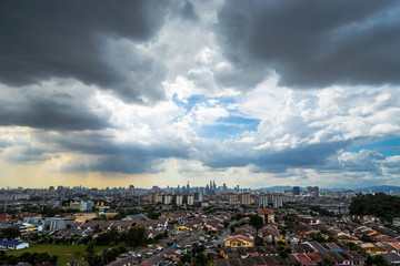 Downtown Kuala Lumpur during cloudy and sunny day