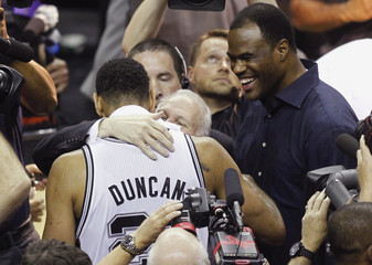 San Antonio Spurs' Tim Duncan hugs coach Gregg Popovich after Spurs defeated Miami Heat in NBA Finals in San Antonio