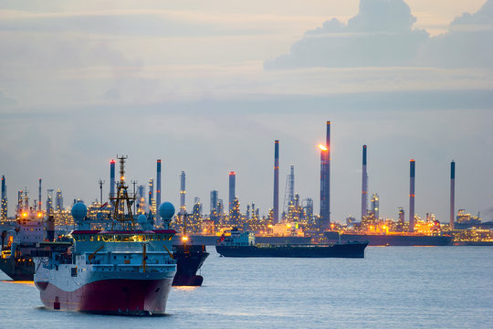 Survey and Cargo Ships off the Coast of Singapore Petroleum Refinery