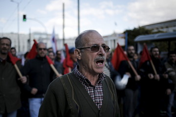 A protester from the Communist-affiliated trade union PAME shouts slogans during an anti-austerity demonstration marking a 24-hour strike in Athens