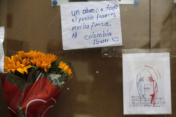 Flowers, drawings and messages are left in remembrance of the victims of the Paris attacks at the French Embassy in Bogota, Colombia,