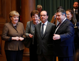 German Chancellor Angela Merkel, Economy Minister Sigmar Gabriel and French President Francois Hollande tour Franco-German digital summit in Berlin