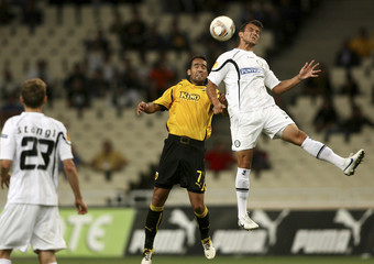 Sturm Graz's Bukva jumps for the ball against AEK Athens' Guerreiro during their Europa League soccer match in Athens