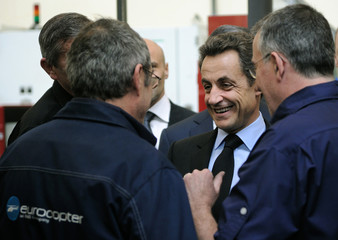 France's President Sarkozy speaks with employees during a visit at a production site of European civil and military helicopter manufacturer Eurocopter in Marignane