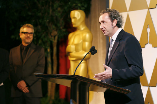 """Director Paolo Sorrentino, who's Italian film """"The Great Beauty"""" is nominated in the Foreign Language Film category, accepts his nomination certificate from presenter director Alfonso Cuaron at the 86th Academy Awards Foreign Language Nominee Rec"""