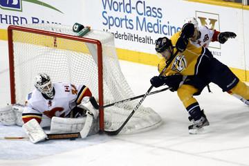 Calgary Flames Miikka Kiprusoff stops a shot from Nashville Predators center Craig Smith during their NHL hockey game in Nashville
