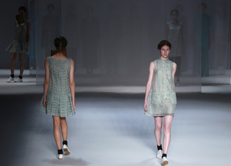 Models present creations from Walter Rodrigues' collection during Fashion Rio Summer 2012