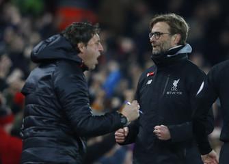 Liverpool manager Juergen Klopp celebrates after Sadio Mane scores their first goal