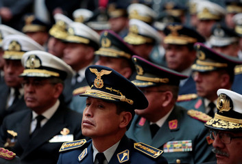 Bolivia's military high ranking officers attend a ceremony at the presidential palace in La Paz