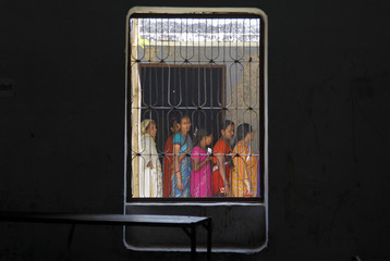 Voters line up to cast their votes at a polling station in the northern Indian city of Allahabad