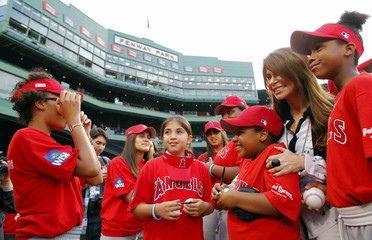 Entertainer Paula Abdul poses for a photograph with Little Leaguers before the MLB Interleague baseball game between the Nationals and the Red Sox at Fenway Park