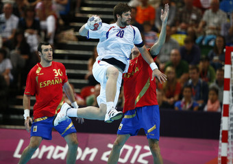 Serbia's Momir Rnic attempts to score against Spain in their men's handball Preliminaries Group B match at the Copper Box venue during the London 2012 Olympic Games