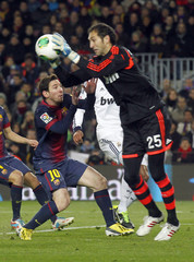 Barcelona's Messi chases Real Madrid's goalkeeper Lopez during their Spanish King's Cup semifinal second round soccer match in Barcelona