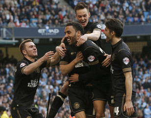 Wigan Athletic's Perch celebrates with teammates after scoring a goal against Manchester City during their English FA Cup quarter final match in Manchester