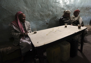Customers sit inside a cafe in the old city of Al-Masnaah in Al-Mahaweet