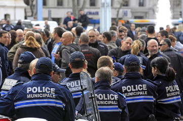French policemen gather in front of the Police headquarters in Marseille to support their colleague seriously injured during a shooting with four men suspected of the burglary of warehouses