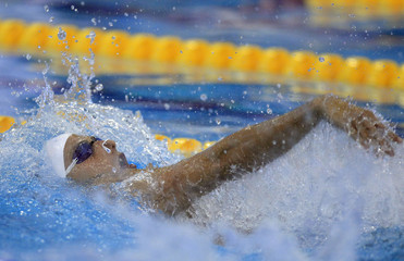 Milli of Italy competes in the men's 200m backstroke heats during the 2012 European Swimming Championships in Debrecen
