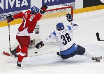 Czech Republic's Prucha celebrates a goal by Krejci next to Finland's Hietanen during their 2012 IIHF men's ice hockey World Championship bronze medal game in Helsinki
