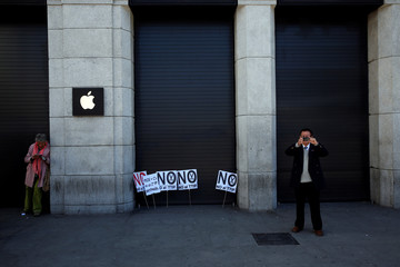 Banners against the free trade agreement TTIP (Transatlantic Trade and Investment Partnership) were left outside an Apple store at the end of a May Day rally in Madrid