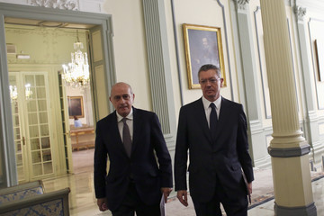 Spain's Justice Minister Gallardon and Spain's Interior Minister Fernandez Diaz head to hold a joint news conference in Madrid