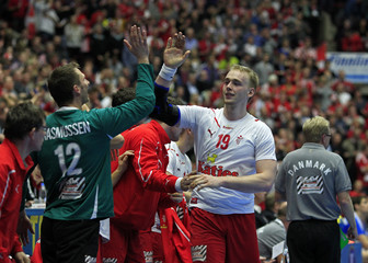 Denmark's Toft and goalkeeper Rasmussen celebrate a goal of their team against Croatia during the Men's Handball World Championship in Malmo