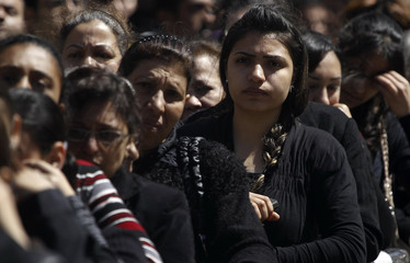Egyptian Christians gather to mourn the death of Pope Shenouda III, the head of Egypt's Coptic Orthodox Church, outside the Abbasiya Cathedral in Cairo