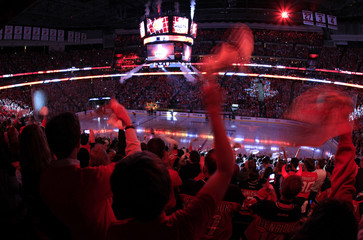 Fans are bathed in red light as they cheer while the Los Angeles Kings and the New Jersey Devils take to the ice before Game 1 of the NHL Stanley Cup hockey final in Newark