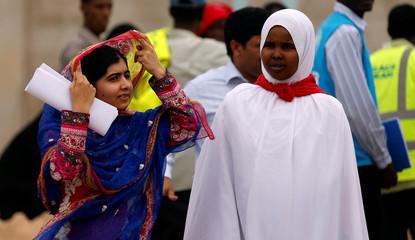 Pakistani Nobel Peace Prize laureate Malala Yousafzai and Somali refugee Rahma Noor arrive for the celebrations to mark Malala's 19th birthday at the Dadaab refugee camp near the Kenya-Somalia border