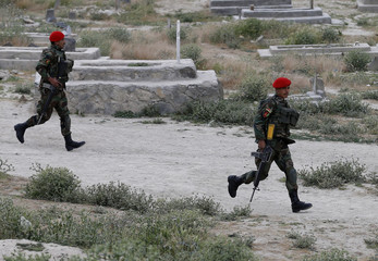 Afghan soldiers arrive at the site of a suicide attack in Kabul