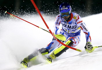 Grange of France clears a gate during the first run in the men's slalom at the Alpine Skiing World Cup in Madonna di Campiglio