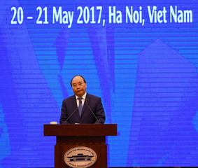 Vietnam's Prime Minister Nguyen Xuan Phuc speaks during the APEC trade ministers' meeting at the National Convention Center in Hanoi
