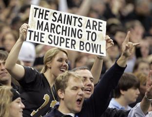 New Orleans Saints fans cheer as their team plays the Arizona Cardinals