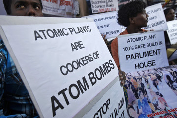 Activists hold placards during a day-long anti-nuclear protest in New Delhi