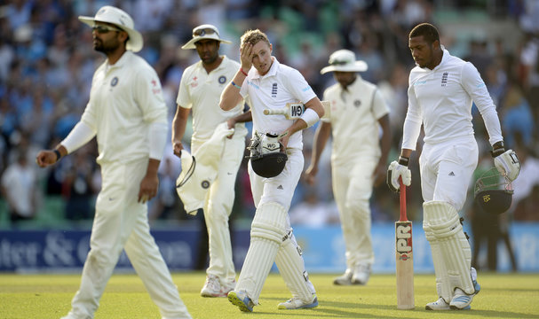 England's Root leaves the field on 92 not out  during the fifth cricket test match against India at the Oval cricket ground, London  August 16, 2014.