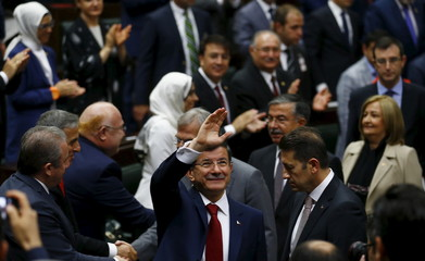 Turkey's Prime Minister Davutoglu greets members of parliament from his ruling AK Party at the Turkish parliament in Ankara