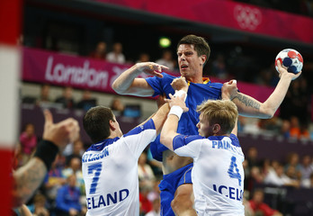 Sweden's Kim Andersson takes a shot against Iceland in their men's handball Preliminaries Group A match at the Copper Box venue during the London 2012 Olympic Games