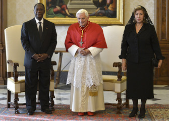 Pope Benedict XVI poses with Ivory Coast President Alassane Ouattara and his wife Dominique during a private audience at the Vatican