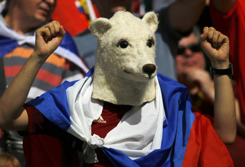 A fan of a Russia poses before the start of the 2014 World Cup Group H soccer against Belgium at the Maracana stadium in Rio de Janeiro