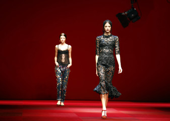 Models present creations from the Dolce & Gabbana Spring/Summer 2015 collection during Milan Fashion week