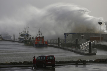 A wave crashes on the protecting wall at the fishing harbour in Pornic, France as stormy weather with high winds hits the French Atlanitic coast