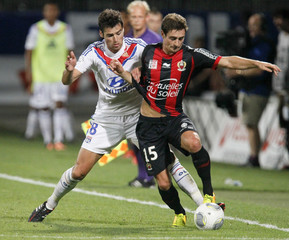 Olympique Lyon's Gourcuff challenges Puel of Nice during their French Ligue 1 soccer match at the Gerland stadium