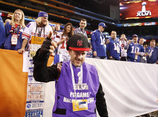 Actor Arquette poses before the Giants play the Patriots in the NFL Super Bowl XLVI football game in Indianapolis