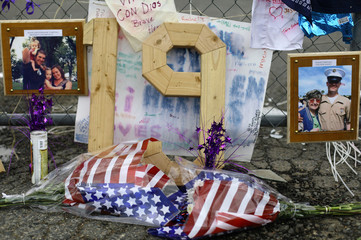 Flowers, pictures, messages and the number 19 is displayed at a makeshift memorial outside the Granite Mountain Interagency Hot Shot Crew fire house in Prescott