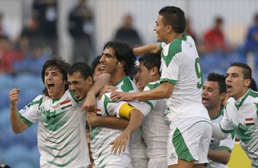 Iraq's players celebrate a goal against Kuwait during their Gulf Cup tournament soccer match at Khalifa Sports City in Isa Town