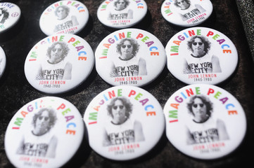 Buttons with pictures of John Lennon sit on a table for sale in Strawberry Fields in New York's Central Park to celebrate the birthday of John Lennon in New York