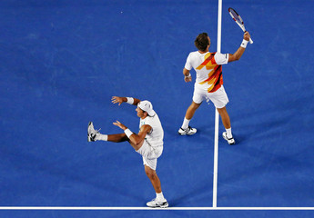 Lindstedt of Sweden and Kubot of Poland celebrate after winning their men's doubles final match against Butorac of the U.S. and Klaasen of South Africa at the Australian Open 2014 tennis tournament in Melbourne