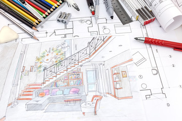 designers workplace with colored hand painted sketch of a living room and drawing tools