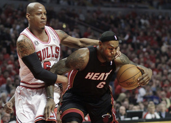 Chicago Bulls' Bogans fouls Miami Heat's James during their NBA playoff basketball game in Chicago