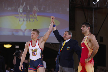 Iran's Tahmasebi stands next to a referee as Dake of the U.S. is declared the winner of their match during the Rumble on the Rails wrestling event held inside Grand Central Terminal in New York